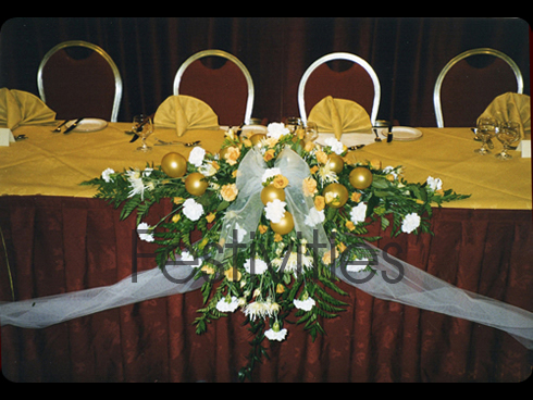 Gold top table with balloons and flowers